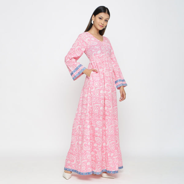 Right View of a Model wearing Pink Paisley Floor-Length Tier Dress