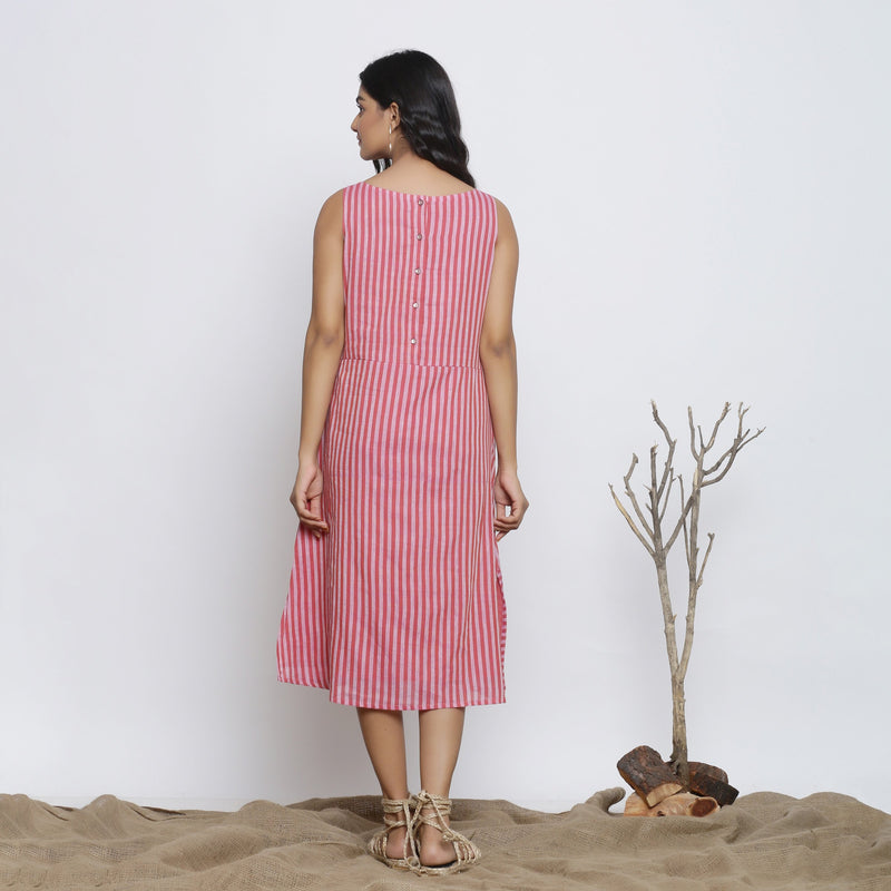 Back View of a Model wearing Pink Striped Sleeveless Paneled Dress
