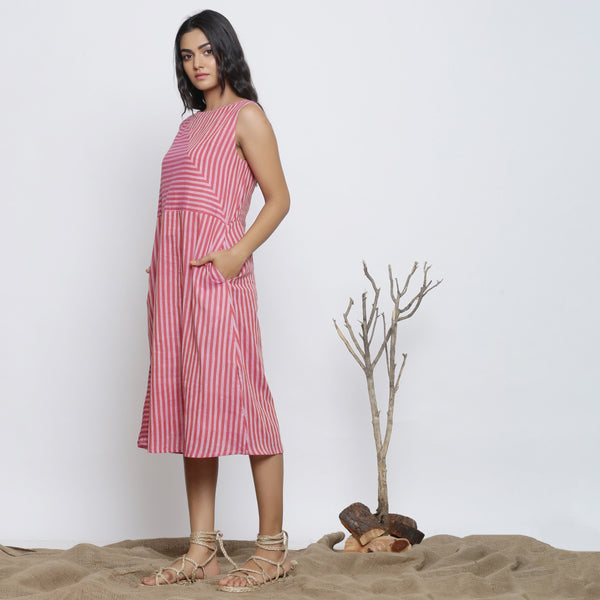 Left View of a Model wearing Pink Striped Sleeveless Paneled Dress