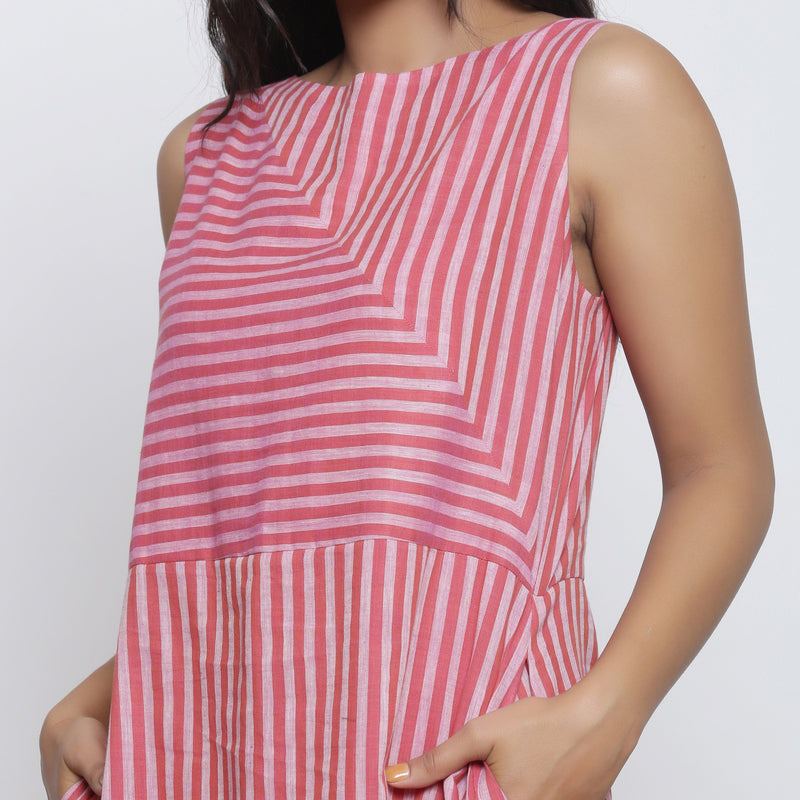 Front Detail of a Model wearing Pink Striped Sleeveless Paneled Dress