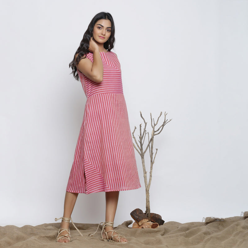 Right View of a Model wearing Pink Striped Sleeveless Paneled Dress