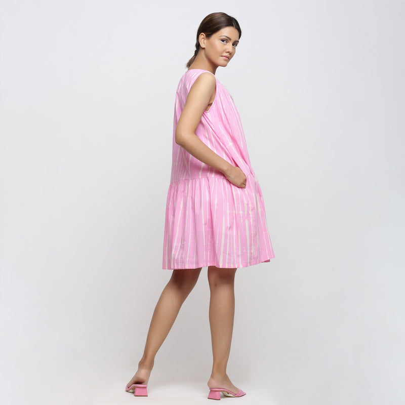 Left View of a Model wearing Pink Tie and Dye Tiered V-Neck Dress