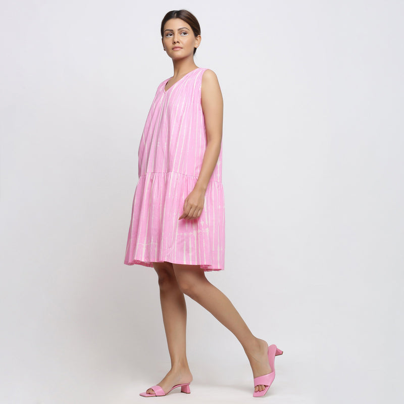 Right View of a Model wearing Pink Tie and Dye Tiered V-Neck Dress