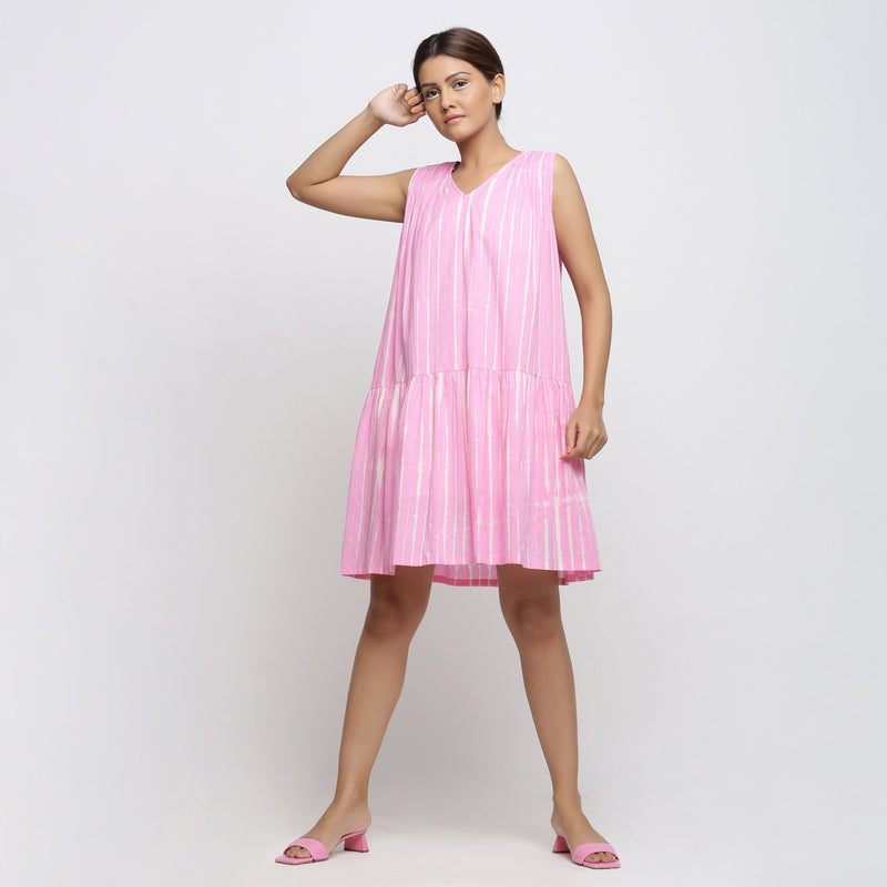 Front View of a Model wearing Pink Tie and Dye Tiered V-Neck Dress