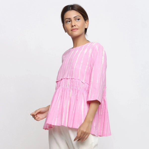Left View of a Model wearing Pink Tie Dyed Flowy Cotton Gathered Top