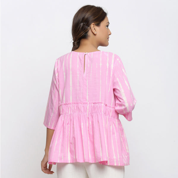 Back View of a Model wearing Pink Tie Dyed Flowy Cotton Gathered Top
