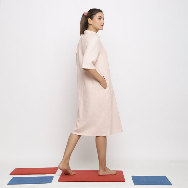 Right View of a Model wearing Pink Vegetable Dyed Button-Down Dress