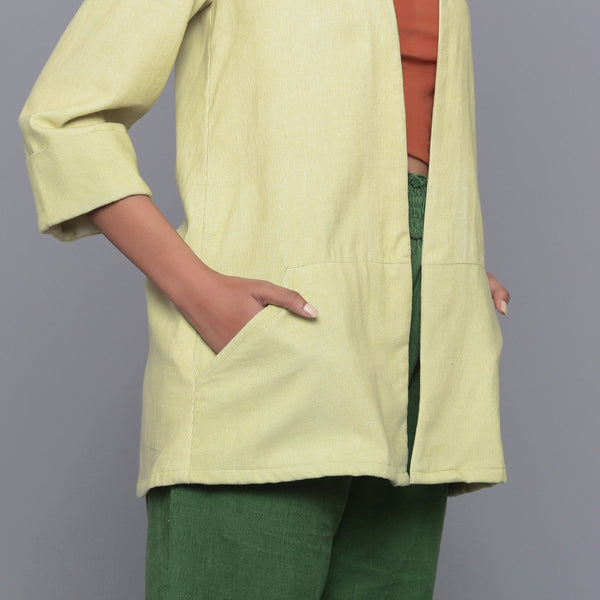 Front Detail of a Model wearing Pistachio Corduroy Front Open Overlay