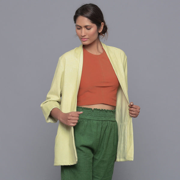 Front View of a Model wearing Pistachio Corduroy Front Open Overlay