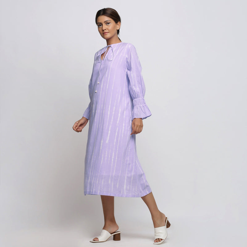 Left View of a Model wearing Poet Sleeves Cotton Lavender Yoke Dress