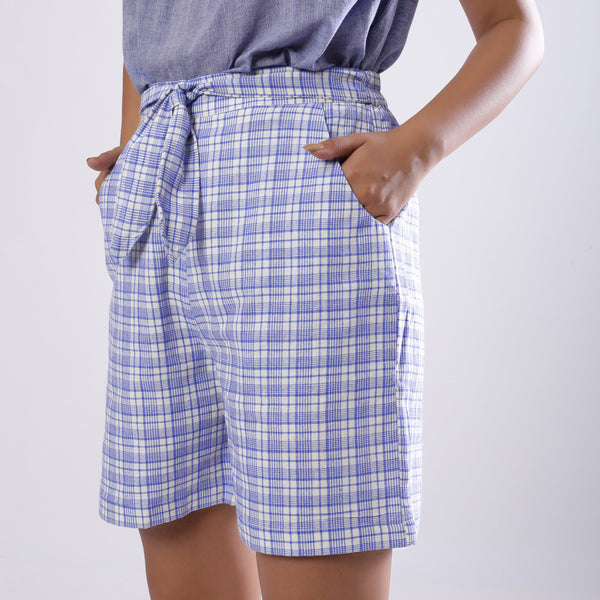 Left View of a Model wearing Powder Blue Checkered Handspun Shorts