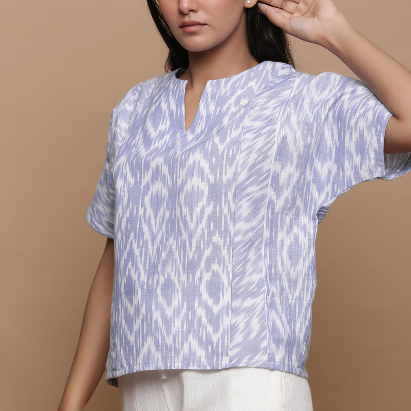Front Detail of a Model wearing Ikat Powder Blue Split Neck Top