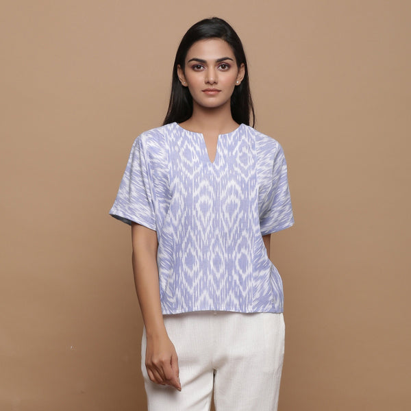 Front View of a Model wearing Ikat Powder Blue Split Neck Top