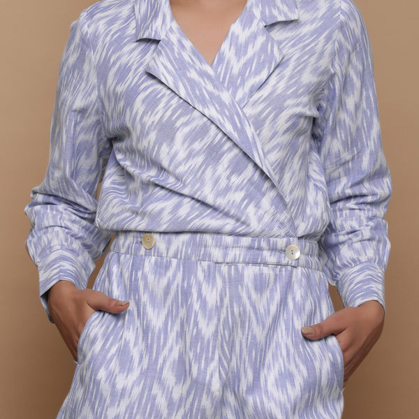 Front Detail of a Model wearing Powder Blue Cuff Sleeves Cotton Romper