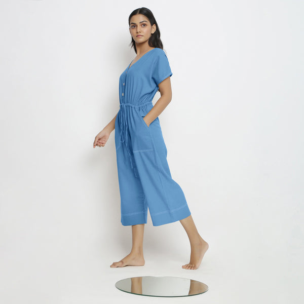 Left View of a Model wearing Powder Blue Vegetable Dyed Button-Down Jumpsuit