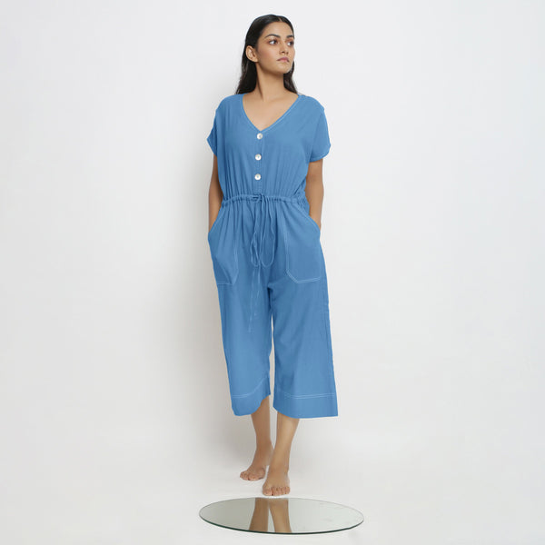 Front View of a Model wearing Powder Blue Vegetable Dyed Button-Down Jumpsuit