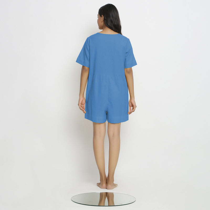 Back View of a Model wearing Powder Blue Vegetable Dyed Romper