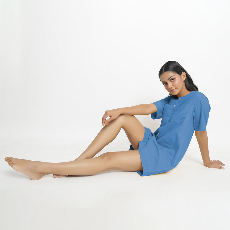 Left View of a Model wearing Powder Blue Vegetable Dyed Romper