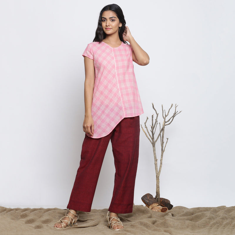 Front View of a Model wearing Powder Pink Checkered Cotton Paneled Top