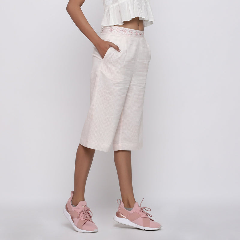 Right View of a Model wearing Powder Pink Mid Rise Straight Culottes