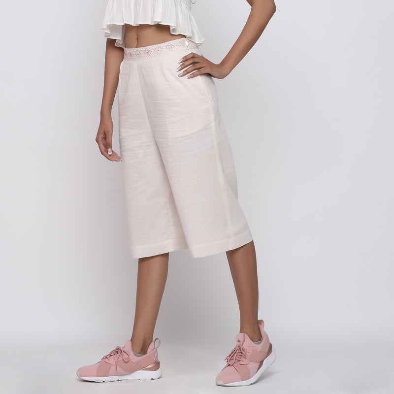 Left View of a Model wearing Powder Pink Mid Rise Straight Culottes