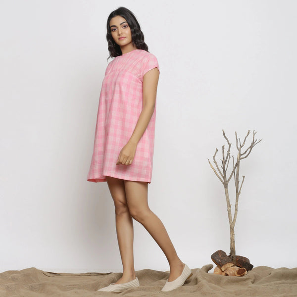 Right View of a Model wearing Powder Pink Handspun Cotton Yoked Dress