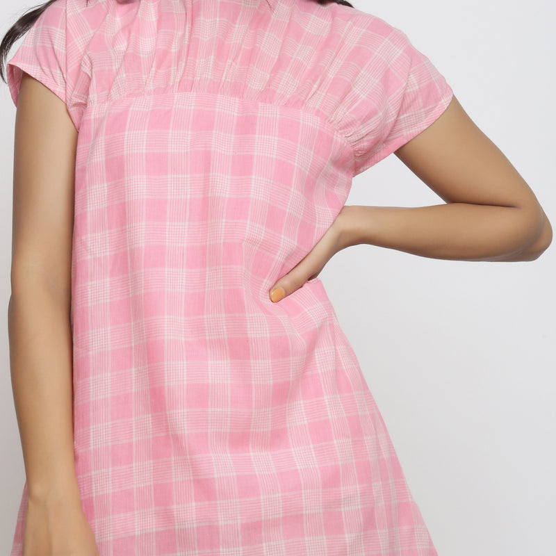 Front Detail of a Model wearing Powder Pink Handspun Cotton Yoked Dress