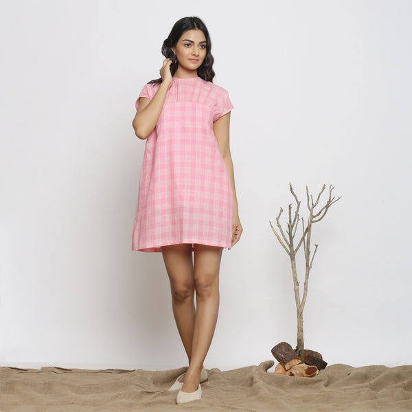 Front View of a Model wearing Powder Pink Handspun Cotton Yoked Dress