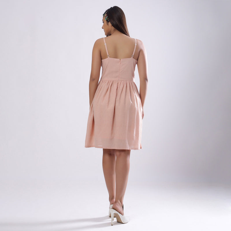 Back View of a Model wearing Powder Pink Handspun Camisole Dress