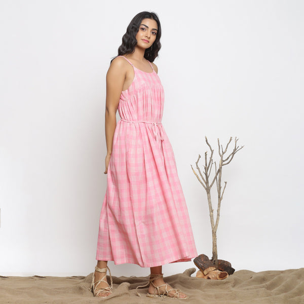 Right View of a Model wearing Powder Pink Handspun Gathered Dress