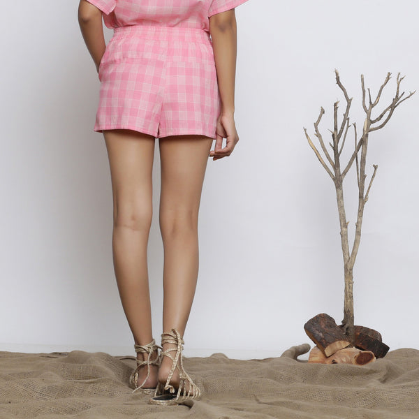 Back View of a Model wearing Powder Pink Handspun Mid Rise Shorts