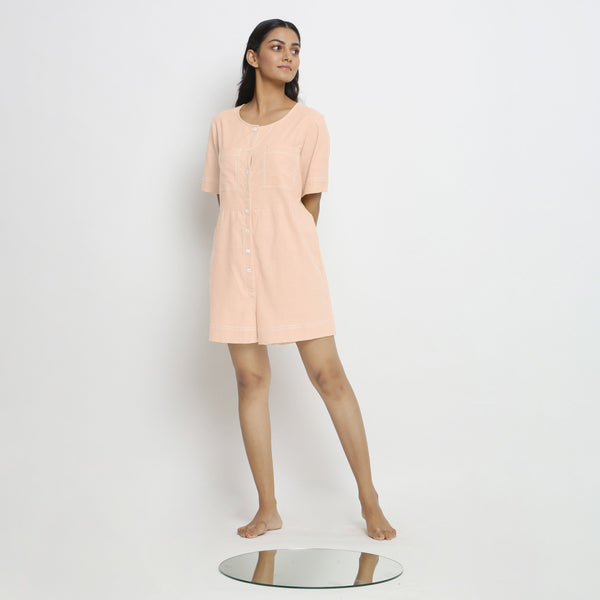Front View of a Model wearing Powder Pink Vegetable Dyed Romper