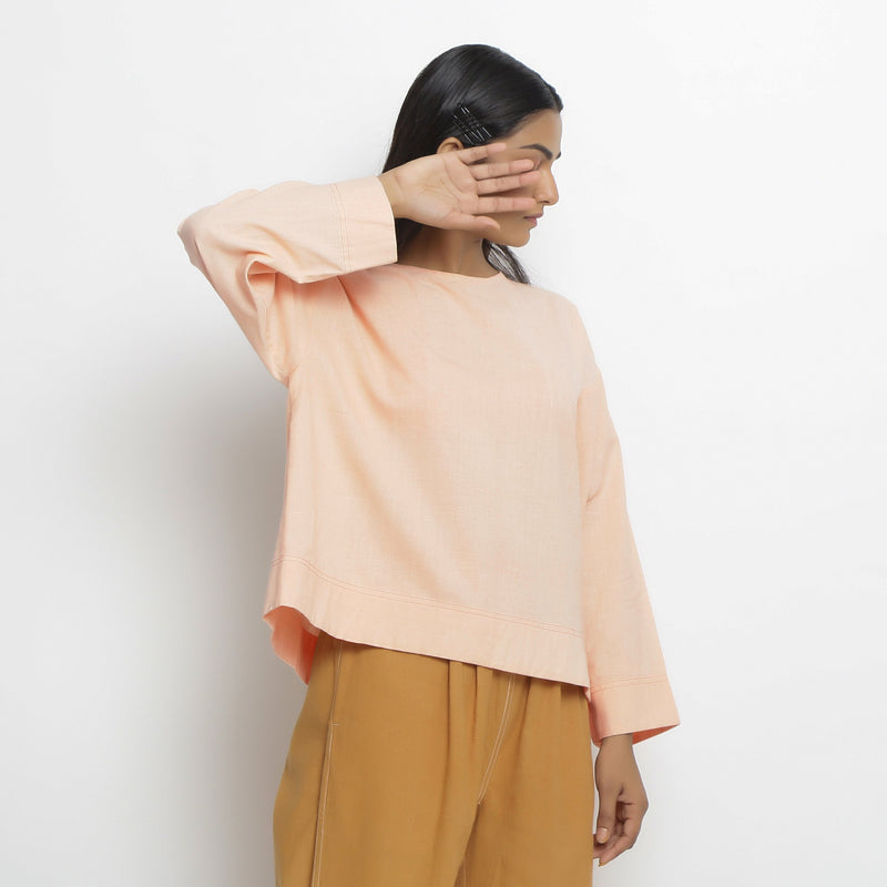 Right View of a Model wearing Powder Pink Vegetable Dyed Straight Fit Top