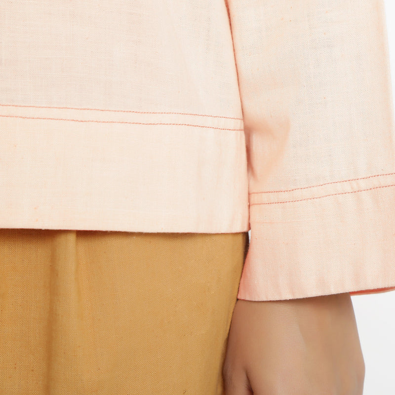 Close View of a Model wearing Powder Pink Vegetable Dyed Straight Fit Top