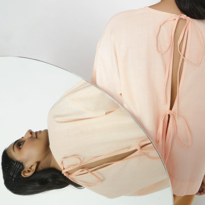 Back View of a Model wearing Powder Pink Vegetable Dyed Straight Fit Top