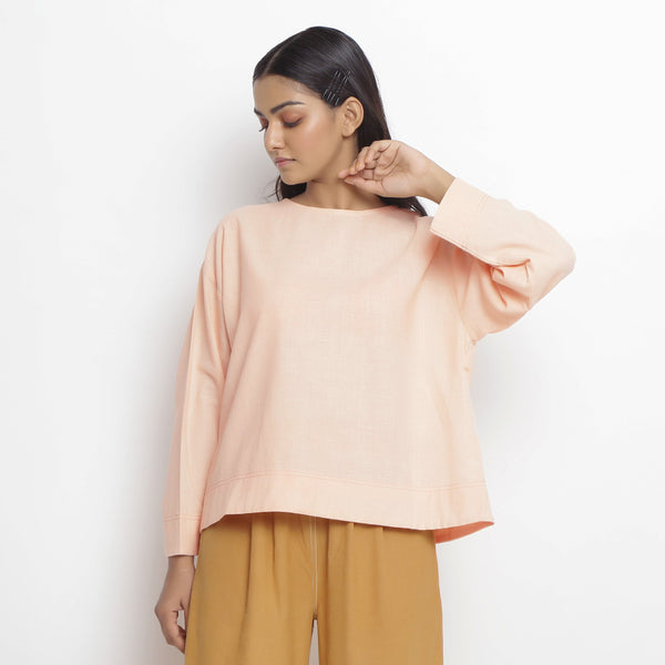 Front View of a Model wearing Powder Pink Vegetable Dyed Straight Fit Top
