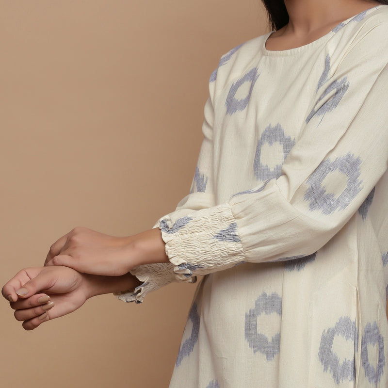 Left Detail of a Model wearing Raglan Sleeves Cotton White Shift Dress