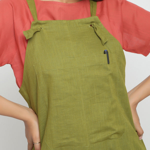 Front Detail of a Model wearing Red Boat Neck Top and Olive Green Dungaree Set