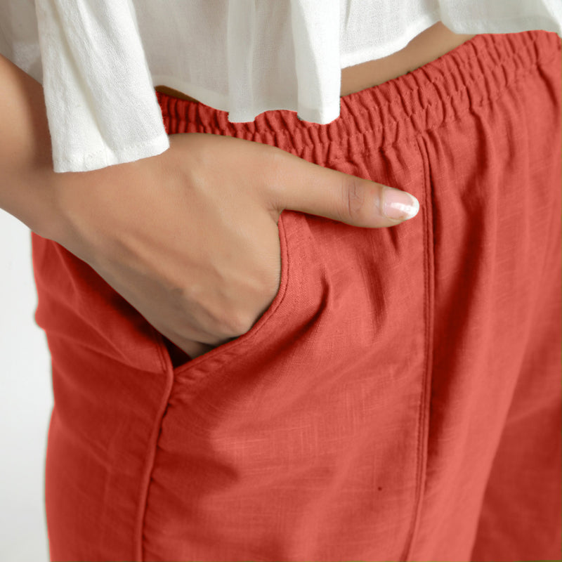Right Detail of a Model wearing Red Wide Legged Straight Pant