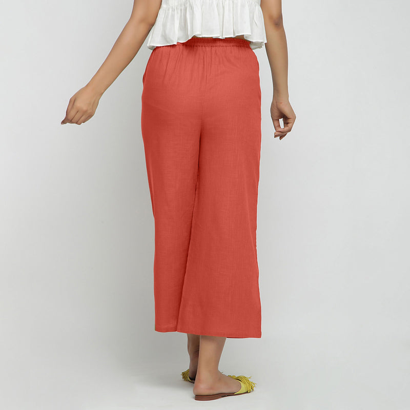 Back View of a Model wearing Red Wide Legged Straight Pant