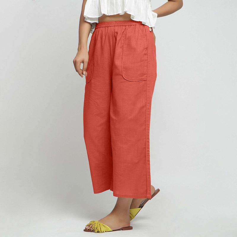 Left View of a Model wearing Red Wide Legged Straight Pant