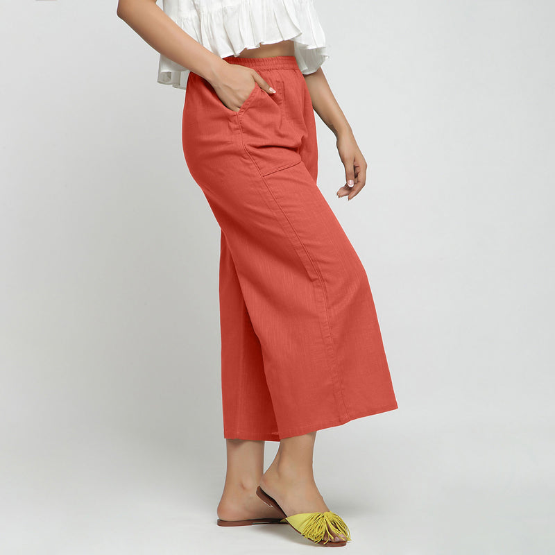 Right View of a Model wearing Red Wide Legged Straight Pant