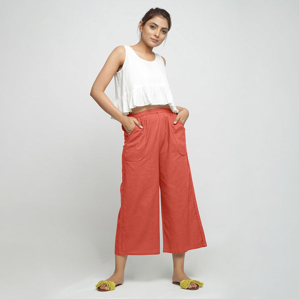 Front View of a Model wearing Red Wide Legged Straight Pant