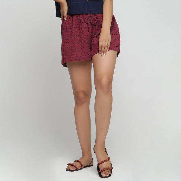 Front View of a Model wearing Red Yarn Dyed Cotton Pleated Shorts