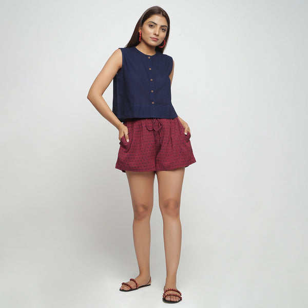 Front View of a Model wearing Red Yarn Dyed Mid Rise Flared Shorts