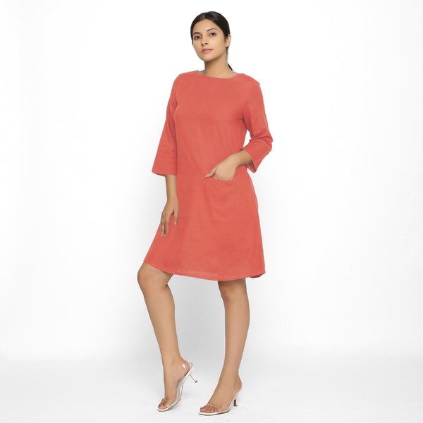 Front View of a Model wearing Red Yoked Cotton Tunic Dress