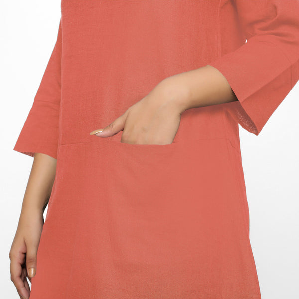 Front Detail of a Model wearing Red Yoked Cotton Tunic Dress
