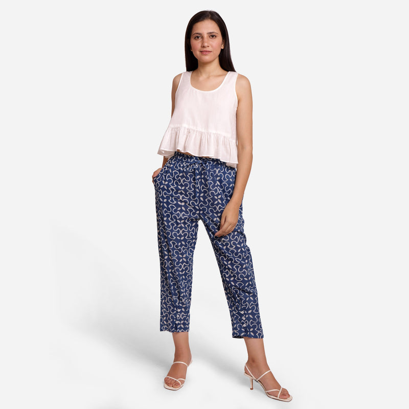 Front View of a Model wearing Flowy White Top and Indigo Pegged Pant Set