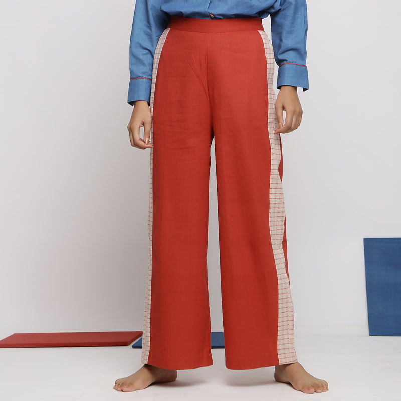 Front View of a Model wearing Brick Red Vegetable Dyed Wide Legged Pant