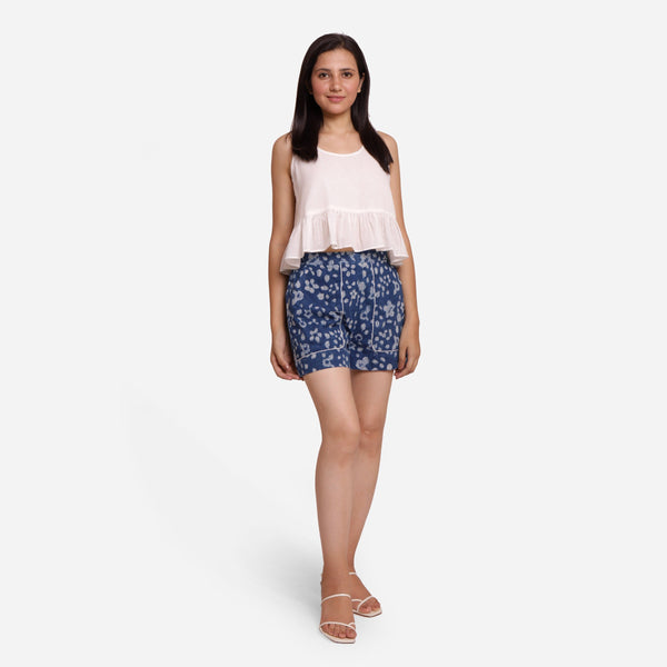 Front View of a Model wearing Relaxed Peplum Top and Indigo Shorts Set